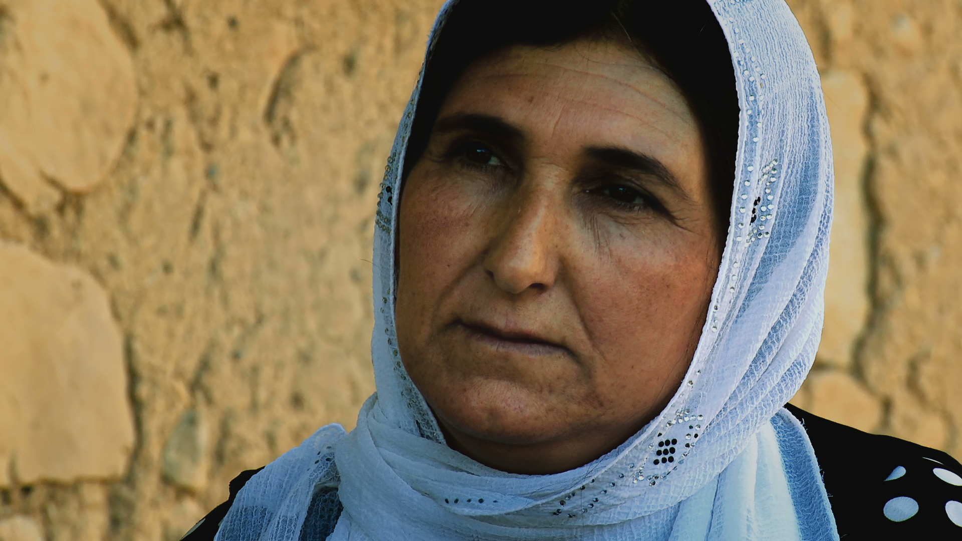 Despite a chemical attack on Askar in May 1988, SAEDA OMAR RASUL stayed behind in her village whilst many fled. She was pregnant and had already lost one child in an attack, but with animals and birds dying around her she escaped to the nearby mountains.