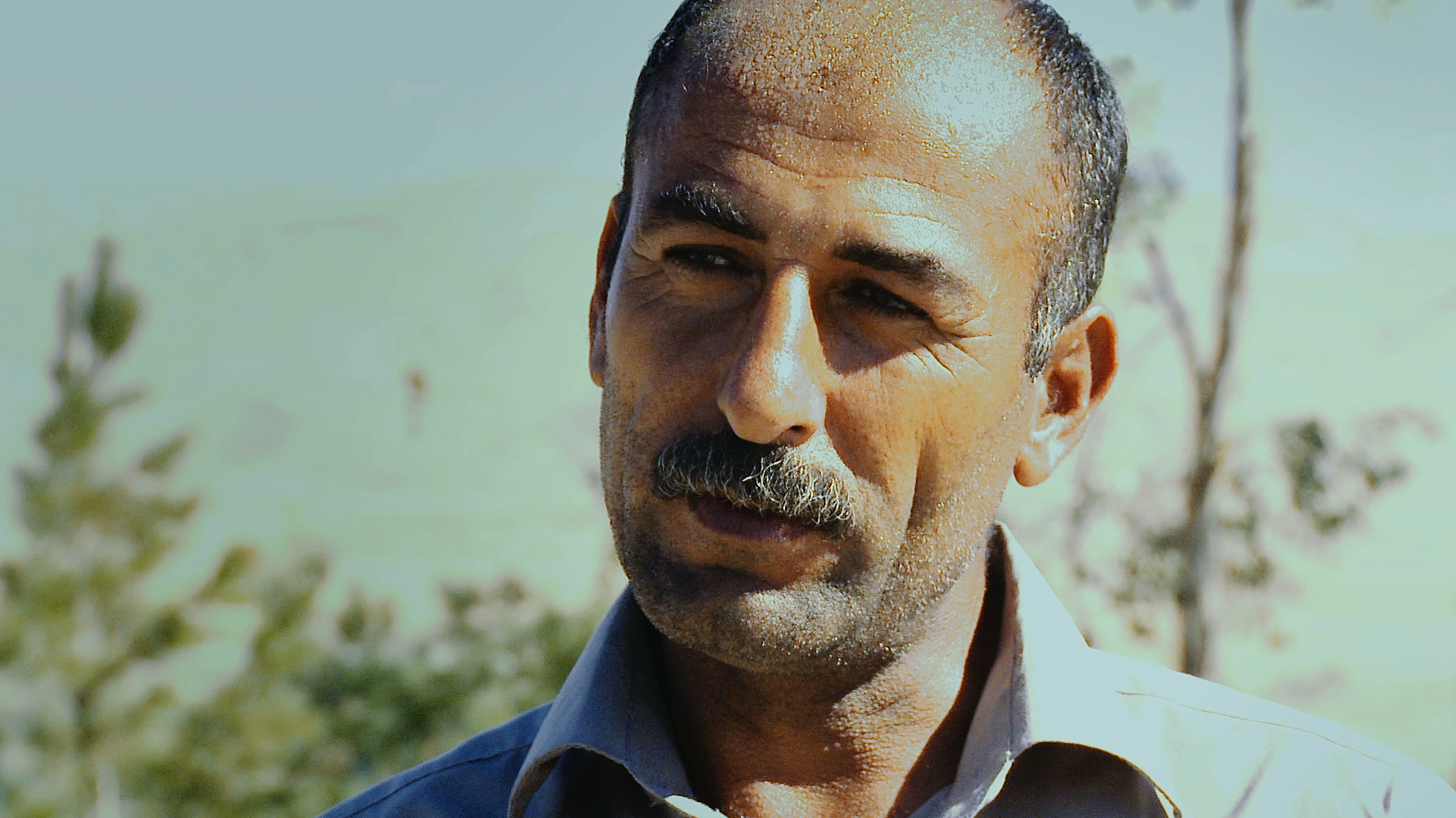 "After a chemical attack in May 1988, MUSTAFA KHADER ISMAEL fled with other villagers from Goptapa. Fearing Mustafa's chemical burns would betray who they were, his companions abandoned him in a field. He experienced extreme pain and despair until a Kurdish collaborator with the Iraqi army (""jash"") unexpectedly helped him find refuge."