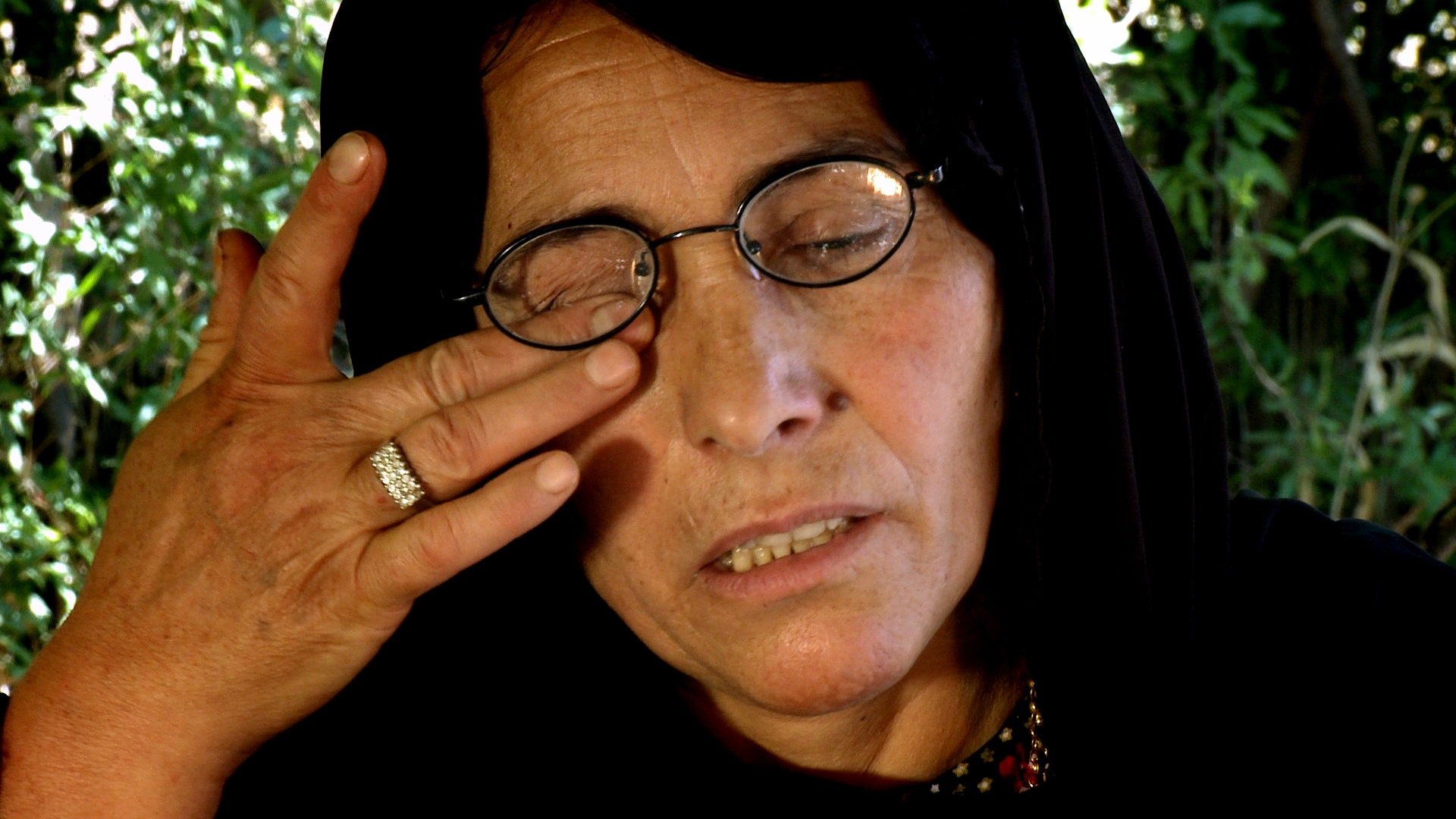 Although vomiting and unable to see, NAJIBA KHADIIR AHMED, escaped into the mountains on a donkey and sheltered in a cave. With her son hungry and in pain beside her, they stayed there until nightfall. Villagers then found them both and brought them to a hospital in Raniya. The next day, they were both imprisoned in Erbil.