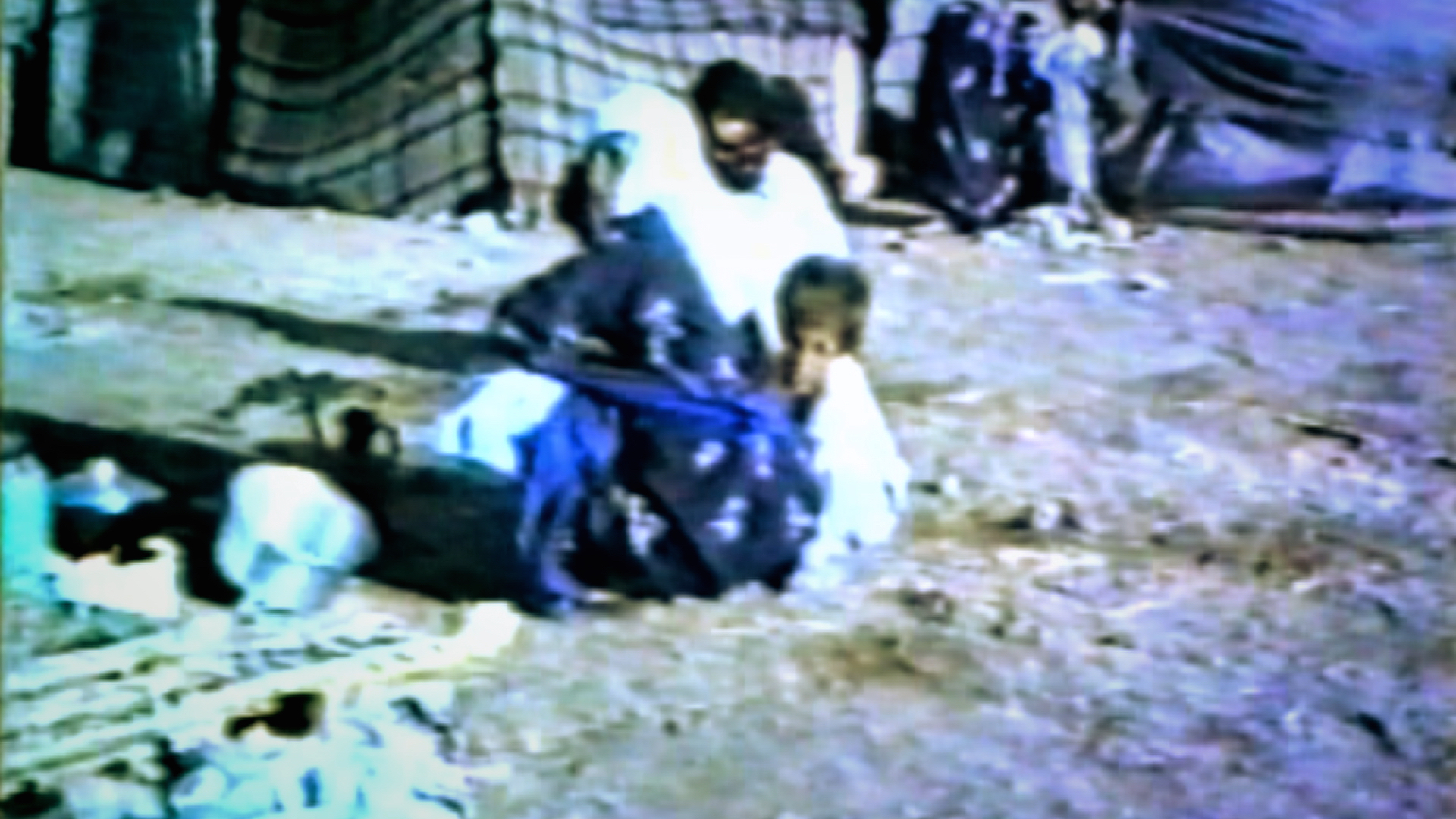 The Anfal survivors in the Baharka internment camp were the mothers, wives and children of Kurdish men executed by the Iraqi authorities. When they arrived they were supported by the local people of Erbil who brought supplies to the camp, but food and water were still in short supply and many of their children died of starvation.