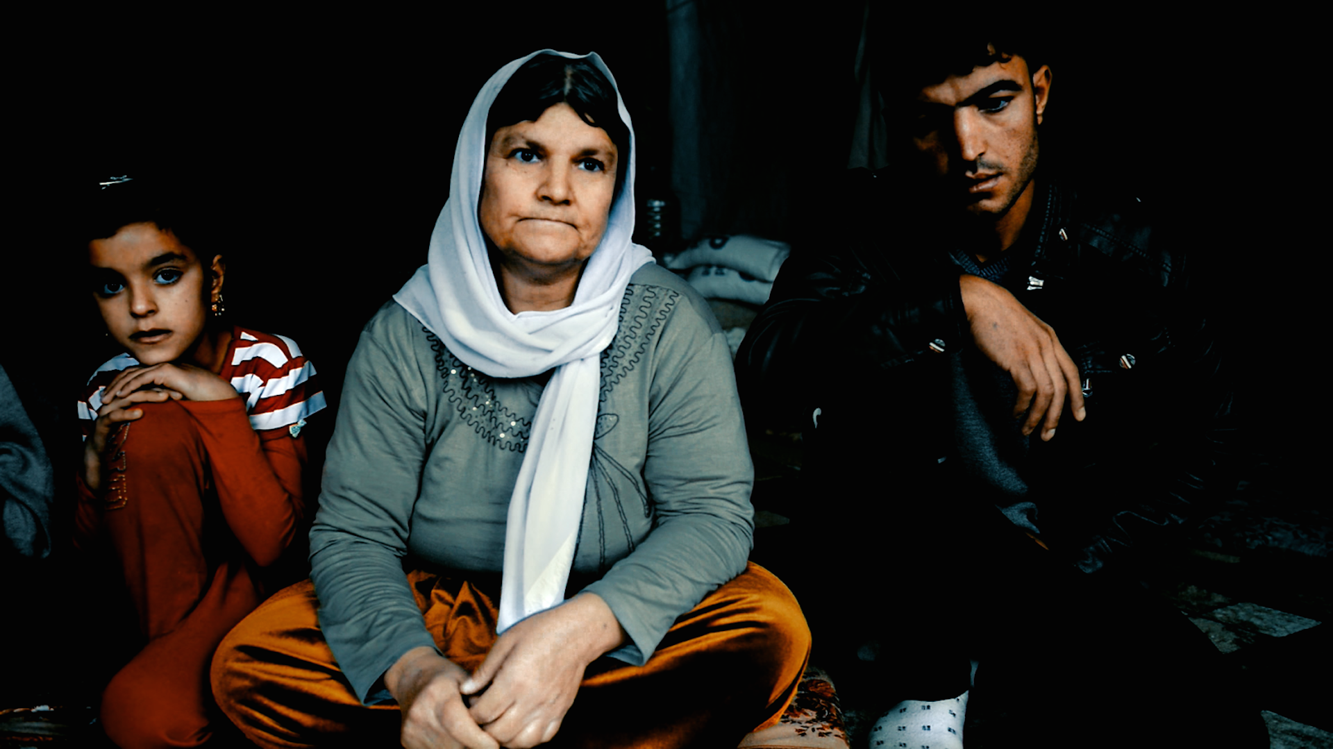 After ISIS overruns the Yazidi heartlands in northwestern Iraq they immediately demand that all Yazidis either convert to Islam or face death. The male members of the Chatto family, who are from the town of Tel Uzeir, refuse and their fate is sealed.