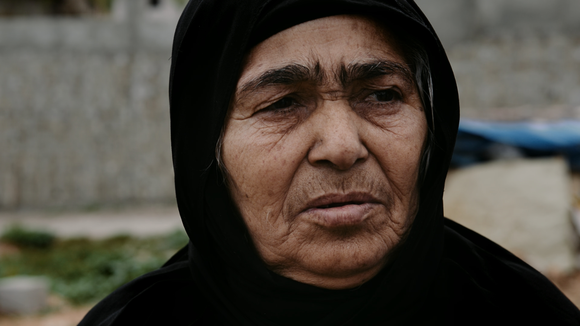 "DOCTOR BAYAN RASUL reminisces with the Barzani women who she helped after their men were abducted in 1983. They describe themselves as ""the living dead,"" but say Doctor Bayan was like a mother to them. The women say they now feel inwardly calm and reassured knowing that their men's remains and belongings are back with them in Barzan."